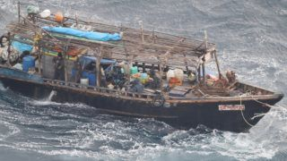 An aerial photo shows a drifting unidentified wooden ship at sea about 13 km northeast off the coast of Kojima, Matsumae, Hokkaido Prefecture on Nov. 28, 2017. The patrol boat of the Japan Coast Guard confirmed that several people are on board. The wooden ship has the possibility of a North Korean poaching boat.  ( The Yomiuri Shimbun )