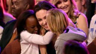INGLEWOOD, CA - MARCH 28: Actress Angelina Jolie hugs Zahara Marley Jolie-Pitt (L) and Shiloh Nouvel Jolie-Pitt (R) after winning award for Favorite Villain in 'Maleficent' during Nickelodeon's 28th Annual Kids' Choice Awards held at The Forum on March 28, 2015 in Inglewood, California.   Kevin Winter/Getty Images/AFP