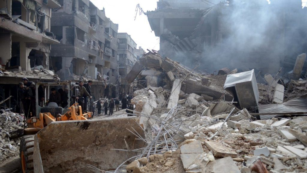 DAMASCUS, SYRIA - FEBRUARY 9: Search and rescue team and people make rescue operations among debris after the Syrian army's warcrafts hit the Eastern Ghouta of Damascus, at least 23 killed and 50 wounded, on February 9, 2015. Yousef Albostany / Anadolu Agency