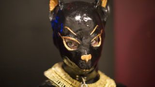 LOS ANGELES, CA - MAY 17:  A submissive woman is dressed as an Egyptian cat at a dungeon party during the domination convention, DomCon LA, in the early morning hours on May 17, 2015 in Los Angeles, California. The annual convention, which was started in 2003 by fetish professional Mistress Cyan, brings together enthusiasts of BDSM and other fetishes.   (Photo by David McNew/Getty Images)