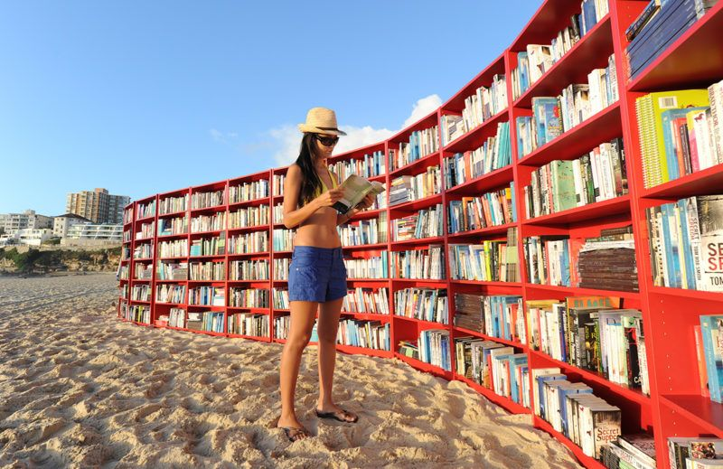 Ikea put the Billy bookcase on Bondi Beach to mark its 30th birthday on January 31, 2010 in Sydney, Australia. To mark the 30th birthday of BILLY, the world's most versatile bookcase, IKEA this morning created the world's longest outdoor bookcase on Bondi Beach. For one day only, Bondi beach is being transformed with 30 red BILLY bookcases snaking their way along the sand, featuring 1000Õs of books to choose from. To take a book, people are being invited to swap one of their books for a book from BILLY shelves or make a gold coin donation, with all donations going to The Australian Literacy & Numeracy Foundation. BILLY on the beach is a day celebrating budgie smugglers, board shorts, bikinis and BILLY bookcases. And as soon as the sun rose on the beach at 6am, locals and visitors began taking to the shelves.