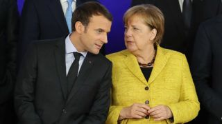 BRUSSELS, BELGIUM - DECEMBER 14:  President of France Emmanuel Macron, and Chancellor of Germany Angela Merkel speak during the launch of the Permanent Structured Cooperation,  (PESCO), a pact between 25 EU governments to fund, develop and deploy armed forces together, at the European Council on December 14, 2017 in Brussels, Belgium. The European Council summit is meeting for two days to discuss issues related to Brexit, defence, education, immigration and foreign policy.  (Photo by Dan Kitwood/Getty Images)