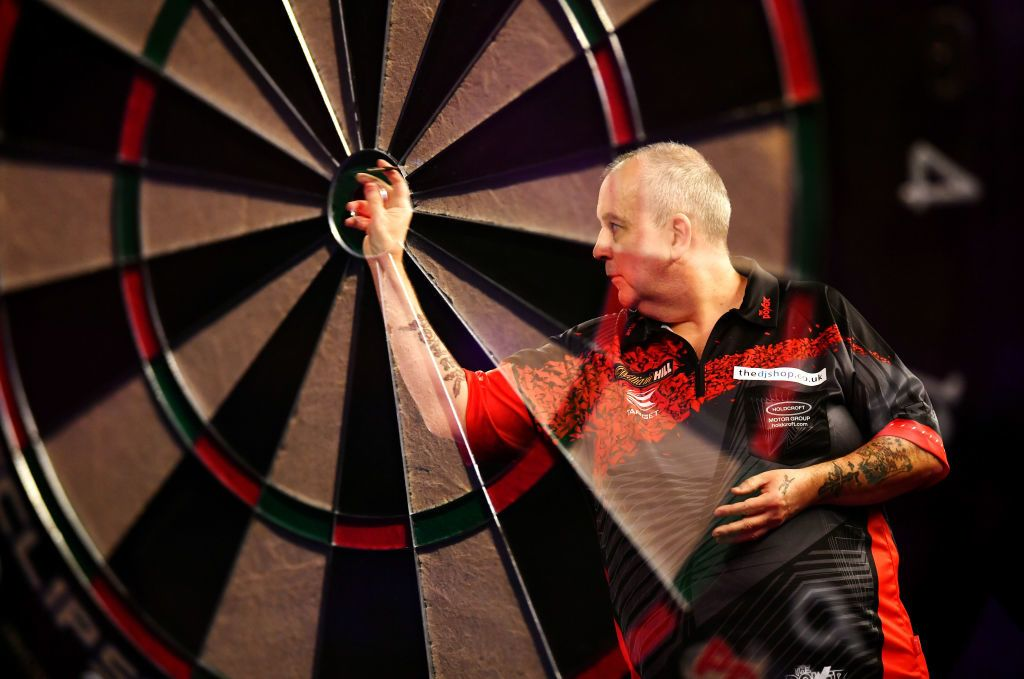 LONDON, ENGLAND - DECEMBER 29:  (EDITORS NOTE: this image is created using an in camera multiple exposure) Phil Taylor in action during his Quarter Final Match against Gary Anderson during the 2018 William Hill PDC World Darts Championships on Day Thirteen at Alexandra Palace on December 29, 2017 in London, England. (Photo by Justin Setterfield/Getty Images)