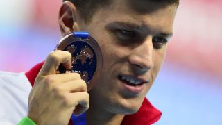 Hungary's Daniel Gyurta, bronze, poses during  the podium ceremony of the men's 200m breaststroke swimming event at the 2015 FINA World Championships in Kazan on August 7, 2015.    AFP PHOTO / ALEXANDER NEMENOV