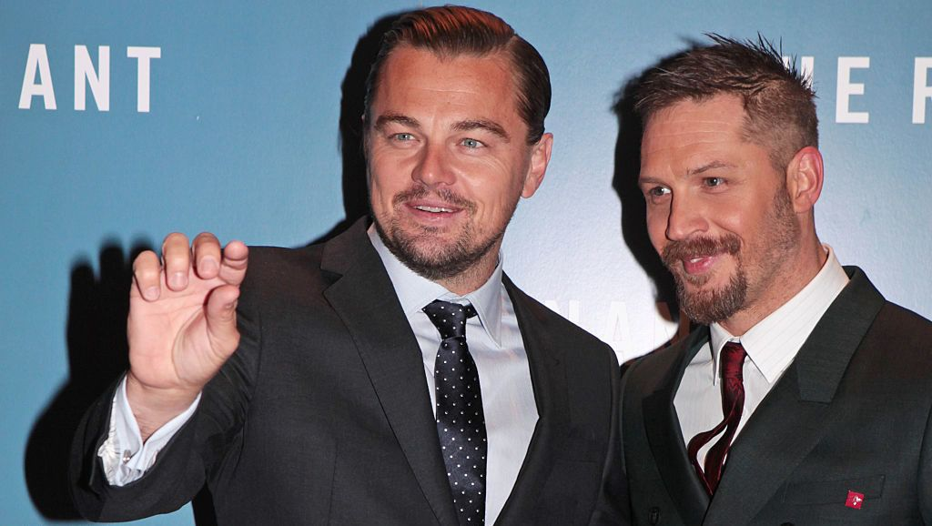 """LONDON, ENGLAND - JANUARY 14:  Leonardo DiCaprio (L) and Tom Hardy attend the UK Premiere of """"The Revenant"""" at the Empire Leicester Square on January 14, 2016 in London, England.  (Photo by David M. Benett/Dave Benett/WireImage)"""