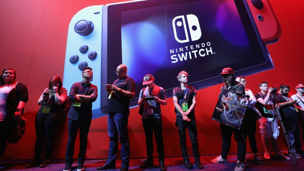 LOS ANGELES, CA - JUNE 13: Game enthusiasts and industry personnel walk past the Nintendo Switch exhibit during the Electronic Entertainment Expo E3 at the Los Angeles Convention Center on June 13, 2017 in Los Angeles, California.   Christian Petersen/Getty Images/AFP