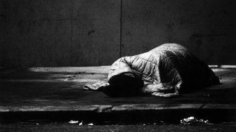 tramp sleeping rough on the street