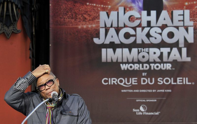 Quincy Jones speaks about pop star Michael Jackson  at  Michael Jackson Immortilized event in Hollywood , California on January 26, 2012.  Jackson's children Prince, Paris and  Blanket  imprinted their hands and their father's sequined glove and shoes in the cement in the famous forecourt of the Grauman's Chinese Theater as family, friends and fans celebrated the legacy of the King of Pop.  AFP PHOTO / Joe KLAMAR / AFP PHOTO / JOE KLAMAR