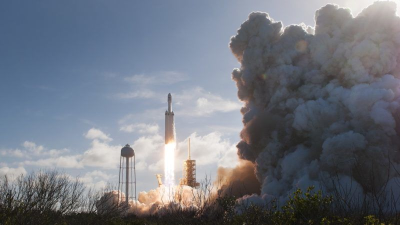 The SpaceX Falcon Heavy launches from Pad 39A at the Kennedy Space Center in Florida, on February 6, 2018, on its demonstration mission. The world's most powerful rocket, SpaceX's Falcon Heavy, blasted off Tuesday on its highly anticipated maiden test flight, carrying CEO Elon Musk's cherry red Tesla roadster to an orbit near Mars. Screams and cheers erupted at Cape Canaveral, Florida as the massive rocket fired its 27 engines and rumbled into the blue sky over the same NASA launchpad that served as a base for the US missions to Moon four decades ago.  / AFP PHOTO / JIM WATSON