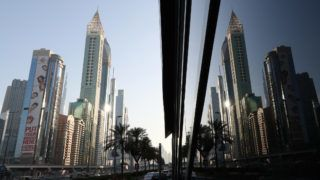 """A picture taken on February 11, 2018, shows the 75-storey Gevora Hotel (L), which stands 356 metres or nearly a quarter of a mile tall, in the Gulf metropolis of Dubai. Gulf metropolis Dubai, on its never-ending quest to break records, announced the opening of the """"world's new tallest hotel"""" Sunday, pipping another towering landmark in the city for the title.  / AFP PHOTO / KARIM SAHIB"""