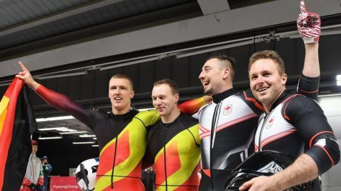 Germany's Francesco Friedrich (L) and Thorsten Margis (2nd L) celebrate with Canada's Alexander Kopacz (2nd R) and Justin Kripps after finishing the in the 2-man bobsleigh heat 4 final run during the Pyeongchang 2018 Winter Olympic Games, at the Olympic Sliding Centre on February 19, 2018 in Pyeongchang.  / AFP PHOTO / Mark Ralston