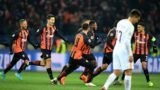 Shakhtar Donetsk's midfielder Fred (C) celebrates with teammates after scoring during the UEFA Champions League round of 16 first leg football match between Shaktar Donetsk and AS Rome at the OSK Metalist Stadion in Kharkiv on February 21, 2018. / AFP PHOTO / SERGEI SUPINSKY