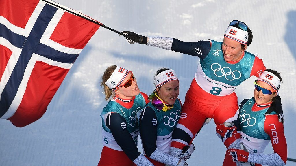 Norway's Marit Bjoergen (2nd R) is carried by her teammates after winning the women's 30km cross country mass start classic at the Alpensia cross country ski centre during the Pyeongchang 2018 Winter Olympic Games in Pyeongchang on February 25, 2018.  / AFP PHOTO / FRANCK FIFE