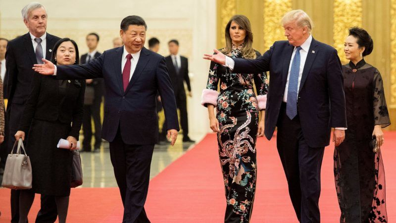 """US President Donald Trump (2nd R) gestures toward China's President Xi Jinping (3rd L), as US First Lady Melania Trump (C) and Xi's wife Peng Liyuan (R) look on, the Great Hall of the People in Beijing on November 9, 2017. Donald Trump urged Chinese leader Xi Jinping to work hard and act fast to help resolve the North Korean nuclear crisis during talks in Beijing Thursday, warning that """"time is quickly running out"""". / AFP PHOTO / Jim WATSON"""