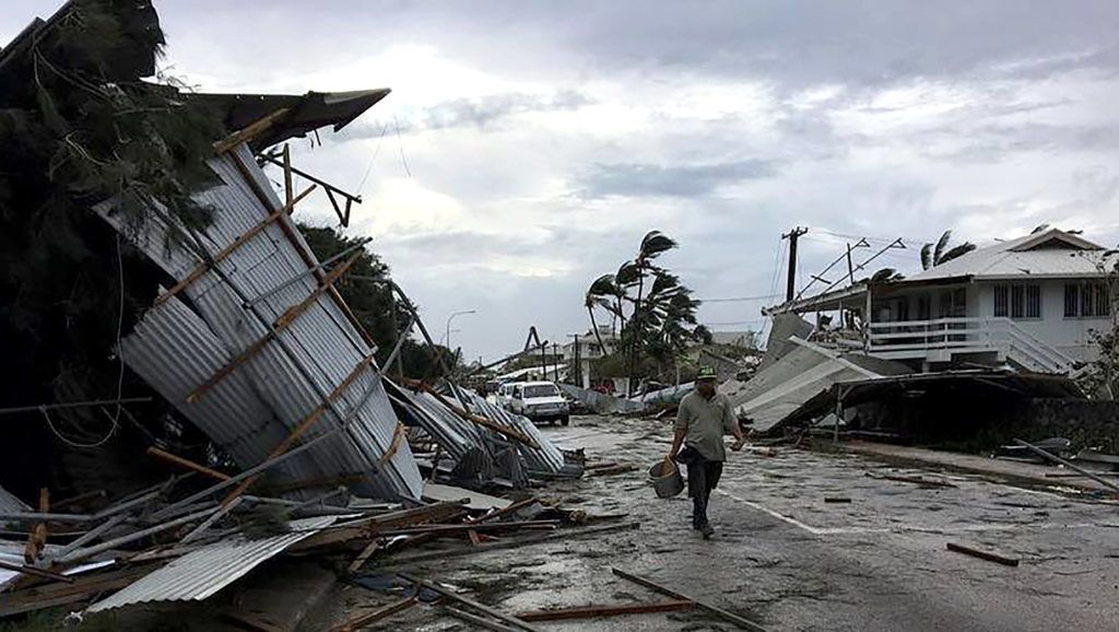 """This handout photo taken and received from John Pulu from Tagata Pasifika on February 13, 2018 shows flooding and damage in Tonga's capital of Nuku'alofa after Cyclone Gita hit the country.   Nuku'alofa awoke to scenes of devastation on February 13 after the most powerful cyclone ever recorded in the Tongan capital tore roofs off buildings, downed powerlines and caused extensive flooding, prompting a state of emergency in the tiny Pacific nation. / AFP PHOTO / JOHN PULU / John PULU / -----EDITORS NOTE --- RESTRICTED TO EDITORIAL USE - MANDATORY CREDIT """"AFP PHOTO / John Pulu / Tagata Pasifika"""" - NO MARKETING - NO ADVERTISING CAMPAIGNS - DISTRIBUTED AS A SERVICE TO CLIENTS - NO ARCHIVES"""