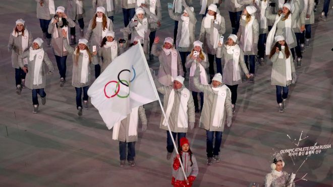 Russian athletes enter the stadium at the opening ceremony of the Winter Olympics in Pyeongchang, South Korea, 9 February 2018. Photo: Daniel Karmann/dpa