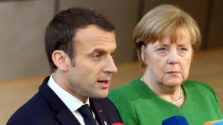 BRUSSELS, BELGIUM - FEBRUARY 23: German Prime Minister Angela Merkel (R) and French President Emmanuel Macron (L) answer the questions of press members as they arrive to attend the EU members' informal meeting of the 27 heads of state or government at European Council headquarters in Brussels, Belgium on February 23, 2018. Dursun Aydemir / Anadolu Agency