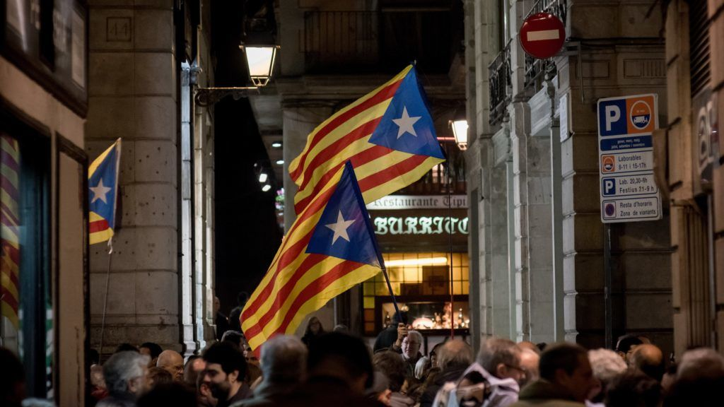 People hold estelades or pro-independence flags during a march in support of imprisoned Catalan leaders in Barcelona, Catalonia, Spain on 16 February, 2018. Former regional ministers Oriol Junqueras and Joaquin Forn, Catalonian civil group Omniuim Cultural's leader Jordi Cuixart and civil group ANC's leader Jordi Sanchez stay in prison accused of rebellion, sedition and embezzlement for the Catalonian pro-independence process.  (Photo by Jordi Boixareu/NurPhoto)