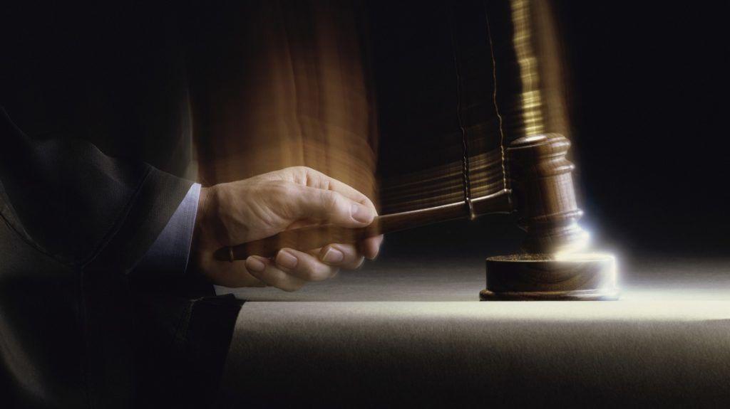 Close-up of a judge handing down a verdict