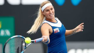MELBOURNE, AUSTRALIA - JANUARY 15:  Dominika Cibulkova of Slovakia plays a forehand in her first round match against Kaia Kanepi of Estonia on day one of the 2018 Australian Open at Melbourne Park on January 15, 2018 in Melbourne, Australia.  (Photo by Michael Dodge/Getty Images)
