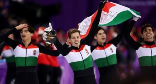 GANGNEUNG, SOUTH KOREA - FEBRUARY 22:  Shaoang Liu, Shaolin Sandor Liu, Viktor Knoch and Csaba Burjan of Hungary celebrate winning the gold medal during the Men's 5,000m Relay Final A on day 13 of the PyeongChang 2018 Winter Olympic Games at Gangneung Ice Arena on February 22, 2018 in Gangneung, South Korea.  (Photo by Richard Heathcote/Getty Images)