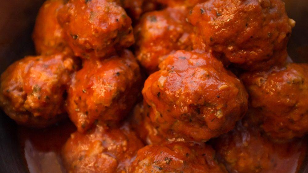 Closeup homemade Italian meatballs in red tomato sauce