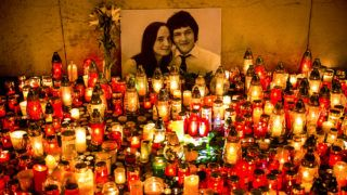 Hundreds of candles have been placed in front of a portrait of Slovak investigative journalist Jan Kuciak and his girlfriend Martina Kusnirova in the center of Bratislava in the night of February 27, 2018.  The body of Jan Kuciak, a 27-year-old reporter for the aktuality.sk news portal owned by Axel Springer and Ringier, was discovered alongside that of Martina Kusnirova at their home in Velka Maca, 65 kilometres (40 miles) east of the Slovak capital Bratislava on February 26, 2018.  / AFP PHOTO / VLADIMIR SIMICEK