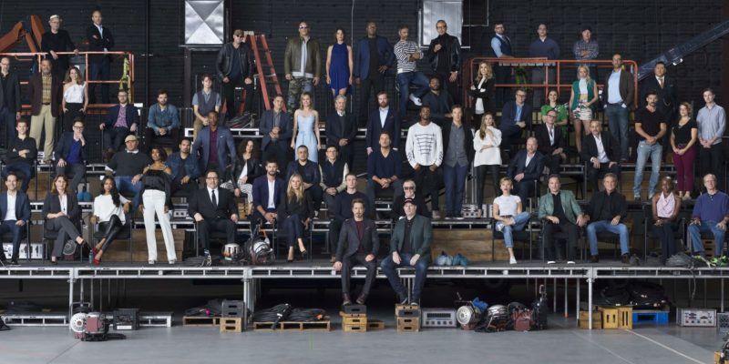 "Marvel Studios ""The First Ten Years"" Class Photo  Front Row L to R: Sean Gunn (Kraglin), Hannah John-Kamen (Ghost), Director Scott Derrickson, Executive Producer Trinh Tran, Jeremy Renner (Hawkeye), Paul Rudd (Ant-Man), EVP, Physical Production Victoria Alonso, Zoe Saldana (Gamora), Angela Bassett (Ramonda), Director/Actor Jon Favreau (Happy Hogan), Chris Hemsworth (Thor), Gwyneth Paltrow (Pepper Potts), Chris Evans (Captain America), Robert Downey Jr. (Iron Man), Executive Producer/Writer Stan Lee, President of Marvel Studios Kevin Feige, Scarlett Johansson (Black Widow), Co-President of Marvel Studios Louis D'Esposito, Kurt Russell (Ego), Danai Gurira (Okoye), William Hurt (Thaddeus Ross), Director Alan Taylor, Karen Gillan (Nebula), Executive Producer Brad Winderbaum, Emily VanCamp (Sharon Carter), Director Louis Letterier   Second Row L to R: Director Jon Watts, Casting Director Sarah Finn, Tessa Thompson (Valkyrie), VP, Physical Production David Grant, Don Cheadle (War Machine), Tom Holland (Spider-Man), Director James Gunn, Dave Bautista (Drax), Michael Peña (Luis), Anthony Mackie (Falcon), Evangeline Lilly (Wasp), Director Joe Russo, Director Anthony Russo, Chris Pratt (Star-Lord), Chadwick Boseman (Black Panther), Benedict Cumberbatch (Doctor Strange), Elizabeth Olsen (Scarlet Witch), Director Joss Whedon, Paul Bettany (Vision), VP, Physical Production Mitchell Bell, Frank Grillo (Crossbones), Director Anna Boden, Director Ryan Fleck, Letitia Wright (Shuri), Editor Jeffrey Ford  Third Row L to R: Director Peyton Reed, Laurence Fishburne (Dr. Bill Foster), Linda Cardellini (Laura Barton), Executive Producer Jonathan Schwartz, Sebastian Stan (Winter Soldier), Ty Simpkins (Harley Keener), Mark Ruffalo (Hulk), Brie Larson (Captain Marvel), Michael Douglas (Hank Pym), Executive Producer Stephen Broussard, Director Ryan Coogler, Michelle Pfeiffer (Janet van Dyne), Executive Producer Jeremy Latcham, Hayley Atwell (Peggy Carter), Pom Klementieff (Mantis), Executive "