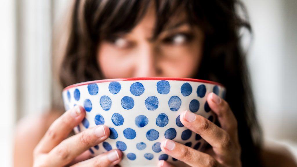 Woman drinking hot beverage.  Paris, France   GARO/PHANIE