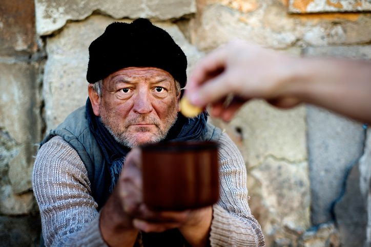 Homless man is begging on the street