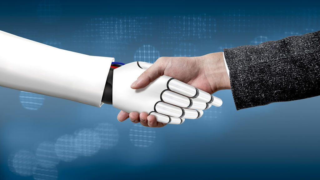 It is a photograph showing a robot and a human being cooperating with each other through a scene of shaking hands.