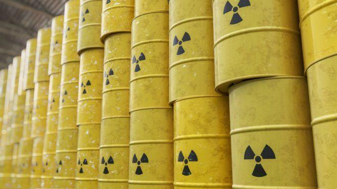 Dumping of radioactive waste barrels. 3D rendered illustration.