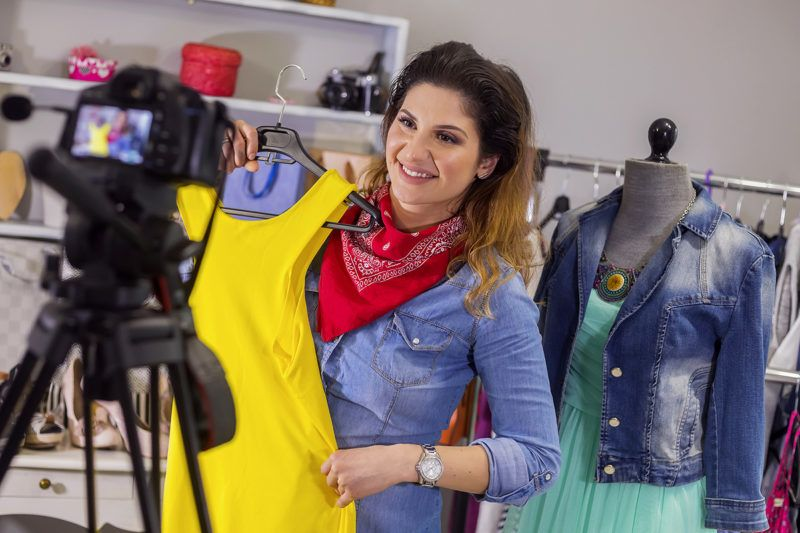 Fashion stylist  vlooger filming in fashion studio