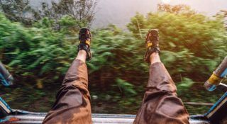 Stretching out my feet, the sri lankan mountain train, the rain wet the pants
