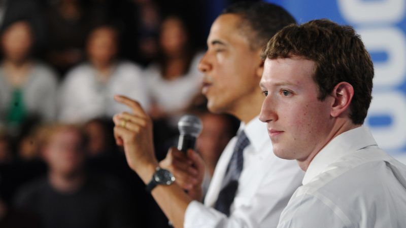 US President Barack Obama speaks as Facebook CEO Mark Zuckerberg looks on during a town hall meeting April 20, 2011 at Facebook headquarters in Palo Alto, California. AFP PHOTO/Mandel NGAN / AFP PHOTO / MANDEL NGAN