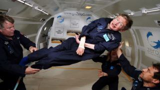 """(FILES) In this file photo taken on April 26, 2007 and released by Zero G, British cosmologist Stephen Hawking experiences zero gravity during a flight over the Atlantic Ocean. """"It was amazing ... I could have gone on and on,"""" Hawking, 65, said after riding for two hours on a modified jet that flew a rollercoaster trajectory to create the impression of microgravity.    Renowned British physicist Stephen Hawking has died at age 76, a family spokesman said Wednesday, March 14, 2018. We are deeply saddened that our beloved father passed away today,"""" professor Hawking's children, Lucy, Robert, and Tim said in a statement carried by Britain's Press Association news agency. """"He was a great scientist and an extraordinary man whose work and legacy will live on for many years.""""  / AFP PHOTO / ZERO G / ZERO G"""