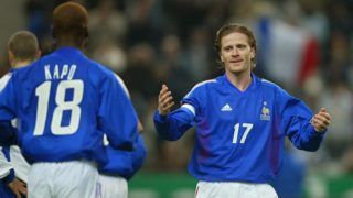 French midfielder and captain Emmanuel Petit (R) congratulate his teammate midfielder Olivier Kapo after he scored their team's third goal during the France/Yugoslavia friendly soccer game 20 November 2002 at the Stade de France in Saint-Denis near Paris.   / AFP PHOTO / PATRICK HERTZOG