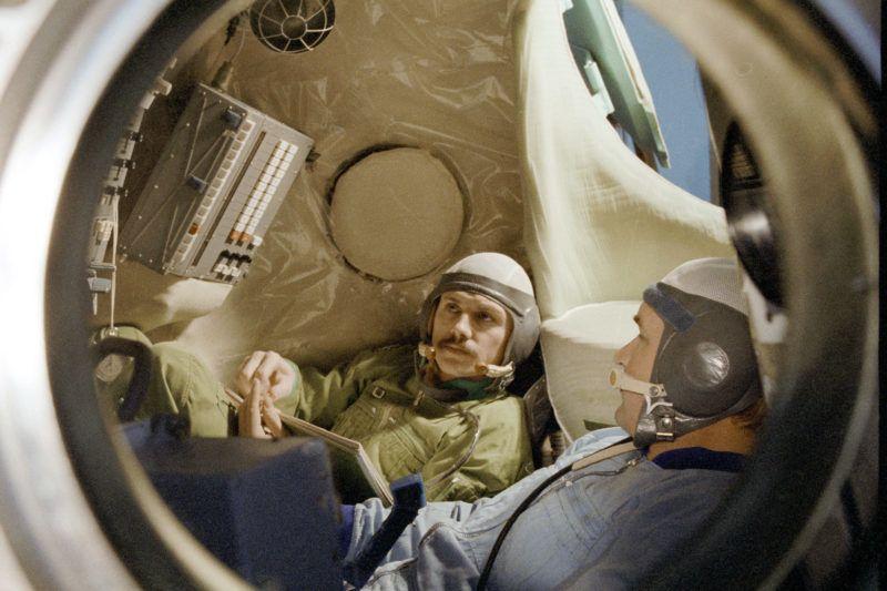 Members of Soyuz-36 international crew - spacecraft commander Valery Kubasov (left) and Hungarian mission specialist Bertalan Farkas (right) - in 'Soyuz' spacecraft simulator.