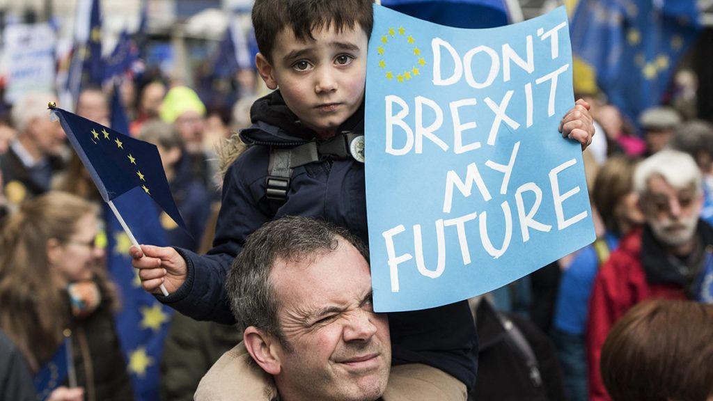A young boy expresses concerns about his future because of Brexit at the Great Northern March against Brexit in Leeds, West Yorkshire in the United Kingdom - March 24, 2018.Un jeune garçon exprime son inquiétude pour son futur lors de la manifestation contre le Brexit 'Great Northern March' ŕ Leeds au Royaume-Uni - 24 Mars 2018.