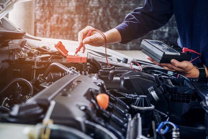 Hands of car mechanic  working in auto repair service.