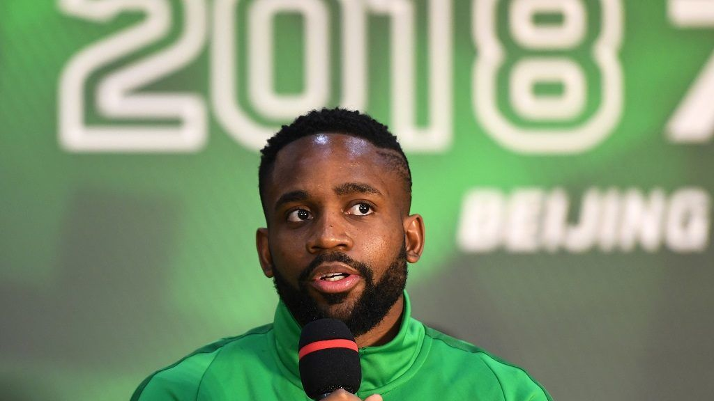 Congolese football player Cedric Bakambu speaks at a press conference by his new team Beijing Guoan in Beijing on March 1, 2018.  Chinese Super League club Beijing Guoan officially presented their new striker Congolese international Cedric Bakambu on March 1, completing a drawn-out transfer saga from his former Spanish team Villarreal. / AFP PHOTO / Greg Baker