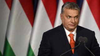 (FILES) This file photo taken on February 18, 2018 shows Hungarian Prime Minister and Chairman of FIDESZ party Viktor Orban delivering his state of the nation speech in front of his party members and sympathizers at Varkert Bazar cultural center in Budapest. A week ago Hungary's right-wing Prime Minister Viktor Orban, campaigning against immigration and George Soros and boosted by a booming economy, looked a shoo-in for another commanding election victory on April 8. / AFP PHOTO / Attila KISBENEDEK