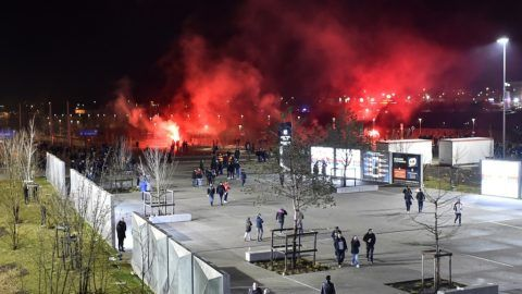 (FILES) In this file photo taken on March 15, 2018 Lyon's fans use red flares before before the Europa League football match Olympique Lyonnais (OL) vs CSKA Moscow on March 15, 2018, at the Groupama Stadium in Decines-Charpieu, central-eastern France. UEFA on March 19, 2018 charged French club Lyon with racist behaviour and crowd disturbances at last week's Europa League match against CSKA Moscow.  / AFP PHOTO / ROMAIN LAFABREGUE