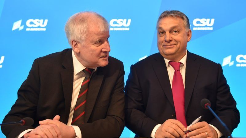 The leader of the German Christian Social Union Party (CSU) Horst Seehofer (L), and Prime Minister of Hungary Viktor Orban talk before a session on the second day of the CSU regional faction retreat in the Seeon Abbey on January 5, 2018 in southern Germany. German Chancellor's Bavarian allies, the CSU, meet over exploratory talks with the Social Democrats on forming Germany's next government.  / AFP PHOTO / CHRISTOF STACHE