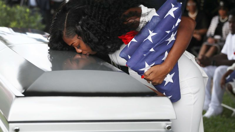 HOLLYWOOD, FL - OCTOBER 21: (One of a 115-image Best of Year 2017 set) Myeshia Johnson kisses the casket of her husband U.S. Army Sgt. La David Johnson during his burial service at the Memorial Gardens East cemetery on October 21, 2017 in Hollywood, Florida. Sgt. Johnson and three other American soldiers were killed in an ambush in Niger on Oct. 4.   Joe Raedle/Getty Images/AFP
