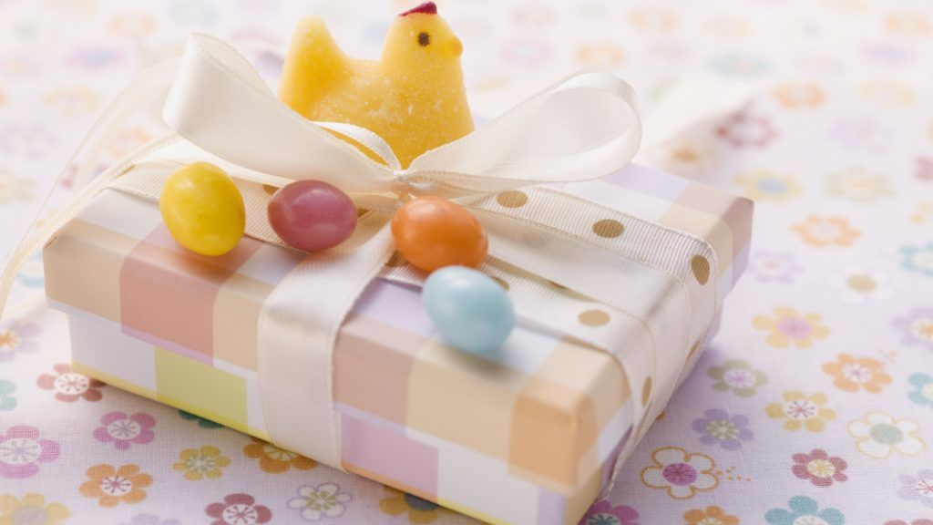 An Easter parcel with a fondant chick and sugar eggs