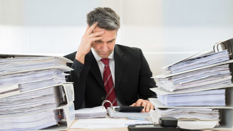 Photo Of Contemplated Businessman Working At Office