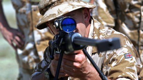 A British soldier of the 7th Battalion rifle regiment look through the scope of a Black Arrow sniper rifle at the Krivolak army training center, 100 km from capitol, Skopje, 22 June, 2007. Some 400 Macedonian soldiers of the First Mechanical Infantry Brigade and 200 British soldiers of the Seventh Battalion Rifle Regiment will participate on a joint bilateral military drill named Macedonian Flash 07, where they exchange military skills in conditions of high temperatures over 40 degrees Celsius similar to those in Afghanistan.   AFP PHOTO / ROBERT ATANASOVSKI / AFP PHOTO / ROBERT ATANASOVSKI