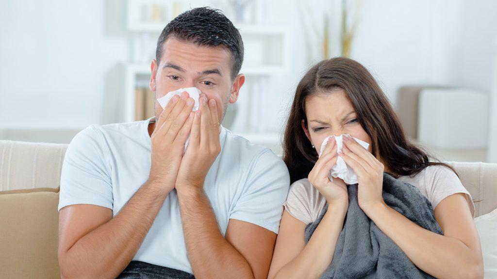 Couple sick on the sofa