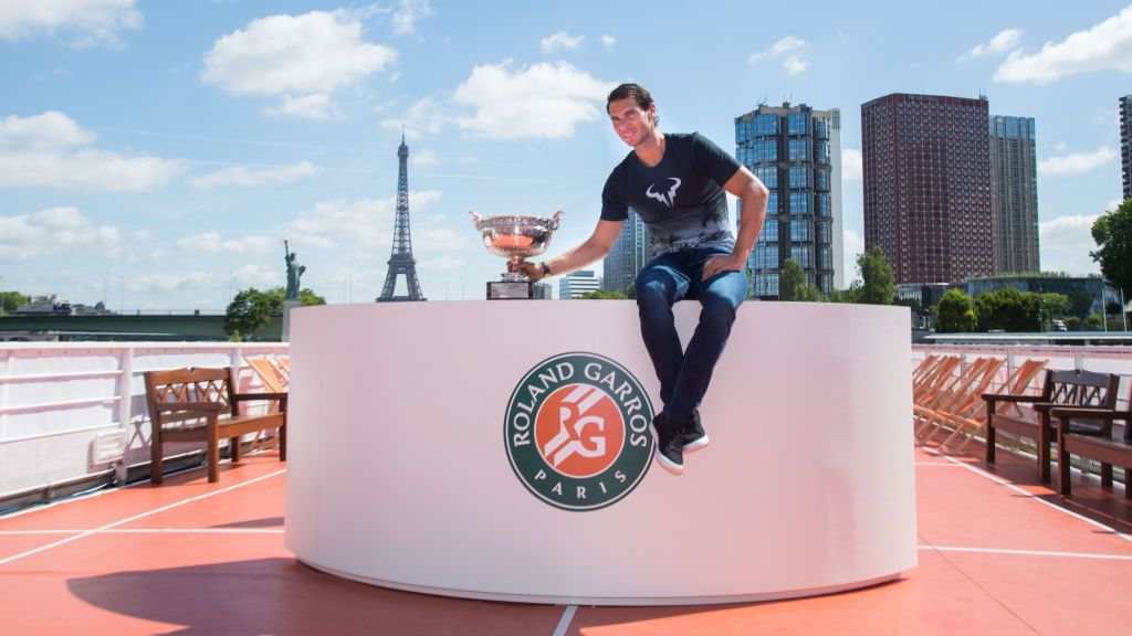 PARIS, FRANCE - JUNE 12:  Rafael Nadal of Spain poses with the winner's trophy next to the Eiffel Tower and the Statue of Liberty Monument during a photocall to celebrate his record breaking 10th French Open title on the Seine River on June 12, 2017 in Paris, France.  (Photo by Stephane Cardinale - Corbis/Corbis via Getty Images)